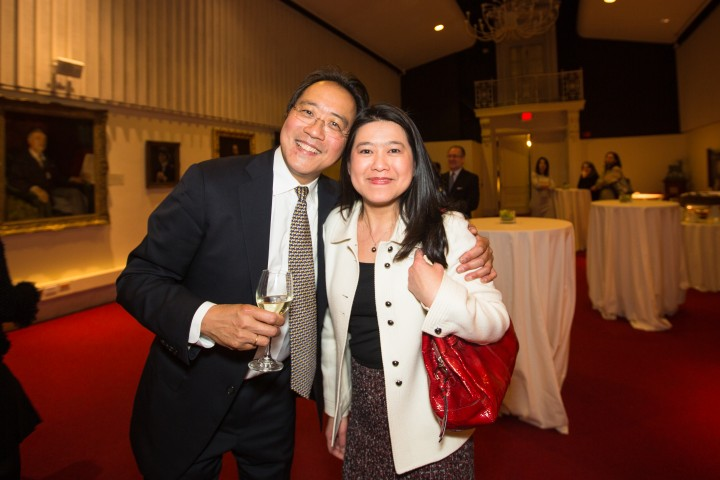 Amy Lam and Yo-Yo Ma embracing and smiling into the camera